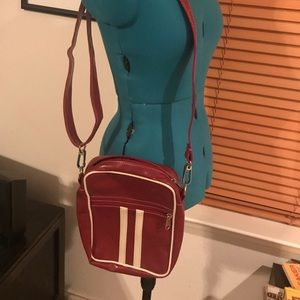Red and white striped pleather cross body bag